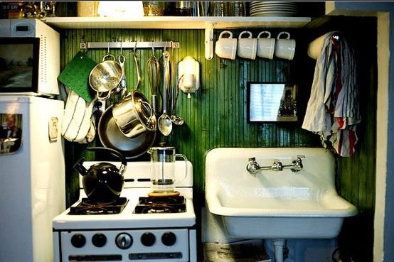 """Mr. Motl covered the walls of his kitchen """"niche"""" with planking from Home Depot that looks like beadboard; he stained it with Minwax's """"green tea,"""" a water-based wood stain, and sealed it with two coats of high-gloss marine varnish."""