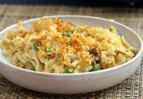 This is an easy tuna noodle casserole recipe made with condensed soup, cheddar cheese, tuna, peas, and cooked noodles.