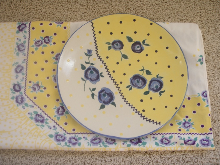 painted pottery plate with matching tablecloth