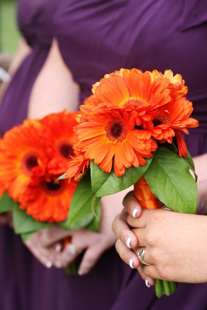 Orange or mixed gerbera daisies  * I am leaning towards a simple bouquet like this for the bridemaids