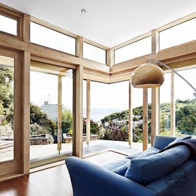 Contemporary Chestnut Glulam Framed Extension on House in Cornwall