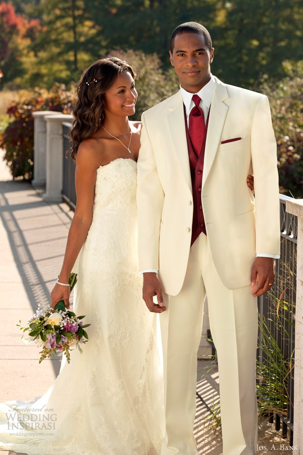 Trendy Troy Ivory Tuxedo with rich burgundy vest tie pocket square Stephen Geoffrey via