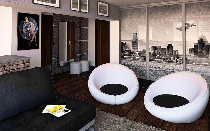 Черный диван и белые кресла