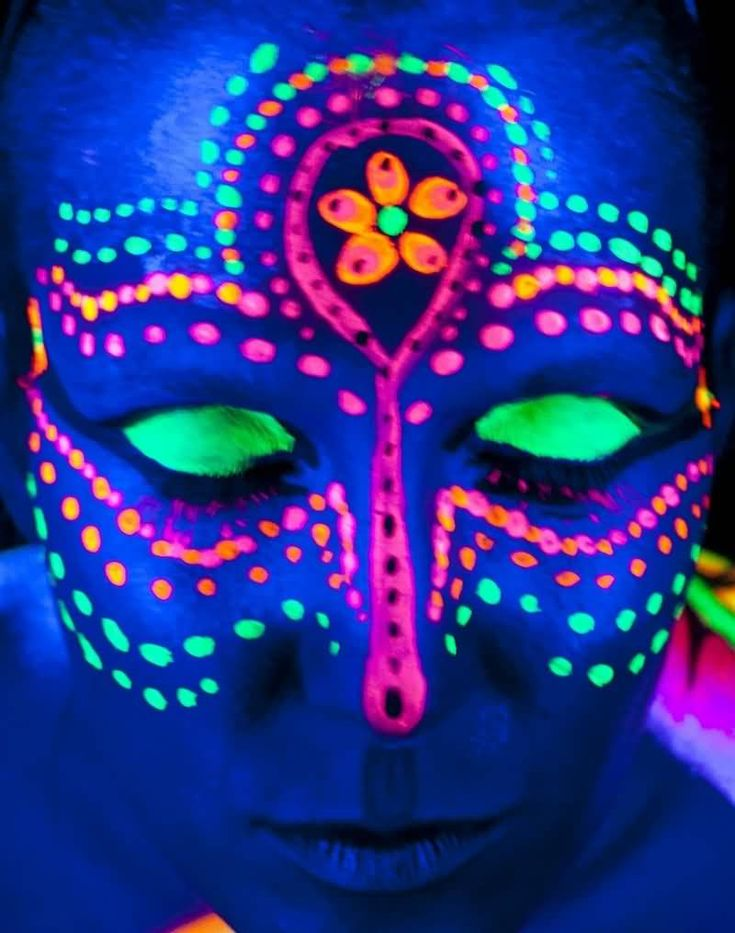 Awesome Uv Rays Colorful Tattoo On Face