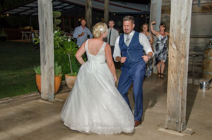 Wedding photographer, Candid Photos of a Lifetime  Bride & Groom shaking it up during their 1st dance as Husband & Wife