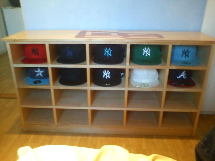 A custom-made cap shelf from New Era fan Fredric T. I like this one the best...I will make mine out of cedar so that no bugs will eat the wool !!