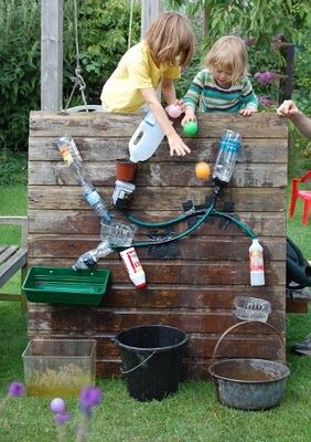 A water wall-i have actually done this on the back of a sand pit and used sand rather than water, wonderful endless hours for kids - NOW, this is a really great idea I haven't seen before