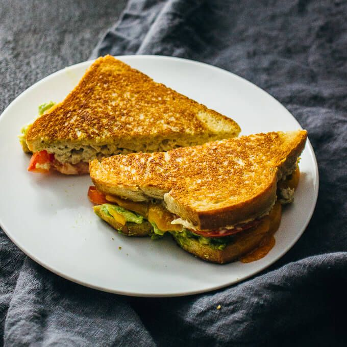 Best recipe for tuna melt sandwiches that are easy, crazy delicious, and healthy! These tuna melts include cheddar cheese, mashed avocado, tomato, and more.
