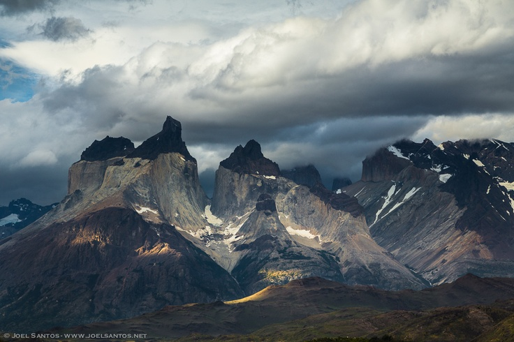 """Patagonia is characterized by sudden weather changes and hence the abrupt changes of light. This image of """"Cuernos del Paine"""", Chile, shows an approaching storm that would fall upon us on the next day. Thanks for your comments throughout this series of photos from Patagonia."""