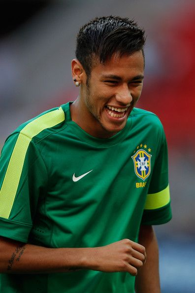 Neymar Photos Photos - Neymar of Brazil smiles during the Brazil Training Session at the FIFA Confederations Cup 2013 at  Estadio Nacional on June 14, 2013 in Brasilia, Brazil. - Brazil Training Session
