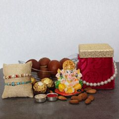 Buy online beautiful rakhi with lord ganesh and delicious sweets on rakhibazaar.com