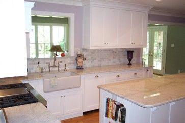 Carrara Subway Tile Backsplash with Matching Basketweave Marble Above Range and bullnose with butcherblock counters.