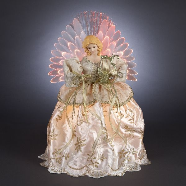 Animated fiber optic angel tree topper wears an ivory lace dress with white flower embroidery and a gold flower bow with pearl at the waistline. Description from timoride.com. I searched for this on bing.com/images: