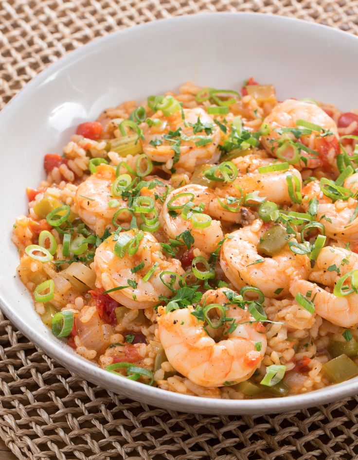 In the Lowcountry region (the coastal areas of the Carolinas and Georgia), perloo is a beloved rice dish often made with the region's plentiful shellfish. Similar to jambalaya, perloo starts with a flavorful base of rice simmered with tomato, bell pepper, celery, garlic and onion. We're making ours with hearty, absorbent bomba rice—a Spanish variety traditionally used for paella—and cooking it risotto-style before stirring in the shrimp right at the end.