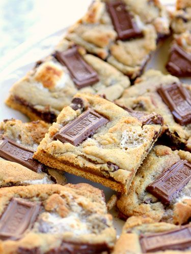 Bake cookie dough on top of graham crackers to make these almost-too-cute-to-eat s'more squares.