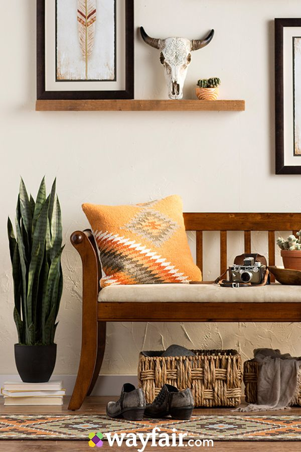 Southwestern patterns, wood furniture, and decor like succulents and bleached wall art make for the perfect rustic look at home.