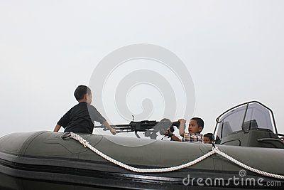 Kids playing a gun