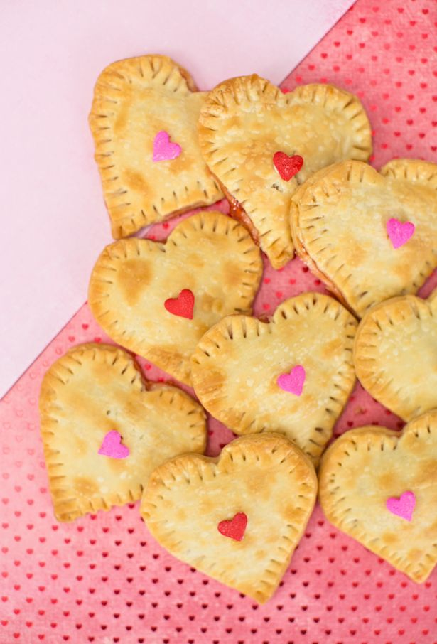 These adorable Mini Heart Hand Pies are perfect for celebrating Valentine's Day. The best part about these pies other than their cute size? They require only 2 ingredients! Click to save this kid-friendly dessert recipe for the upcoming holiday.