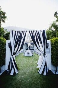 Could make curtains like this for the door ways and windows for Halloween. Use the cheap $2.99-$3.99 per yard fabric. Don't sew the colors together, make small individual panels. Looks good