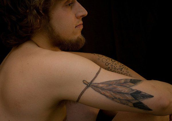 feather tattoo on arm - 50 Beautiful Feather Tattoo Designs