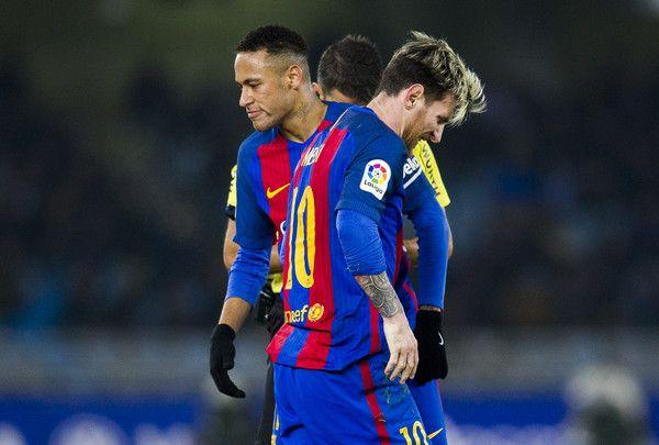Lionel Messi and Neymar of FC Barcelona reacts during the La Liga match between Real Sociedad de Futbol and FC Barcelona at Estadio Anoeta on November 27, 2016 in San Sebastian, Spain.