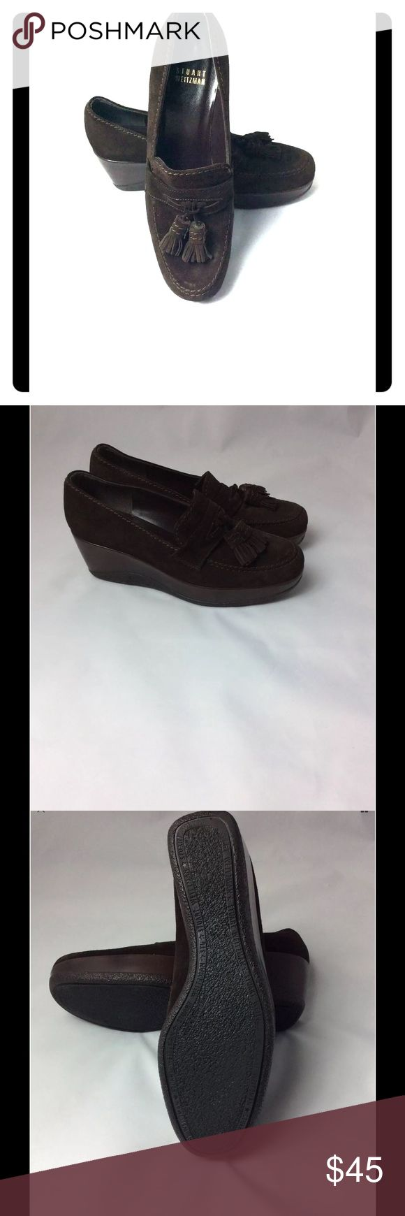 Stuart Weitzman Wedge Loafers With Tassel Brown Pre-loved Authentic Stuart Weitzman wedge loafers. Shoes are in excellent condition with signs of wear on the bottom of shoe. See photos. Material is suede. Size is 7 USA Stuart Weitzman Shoes Wedges