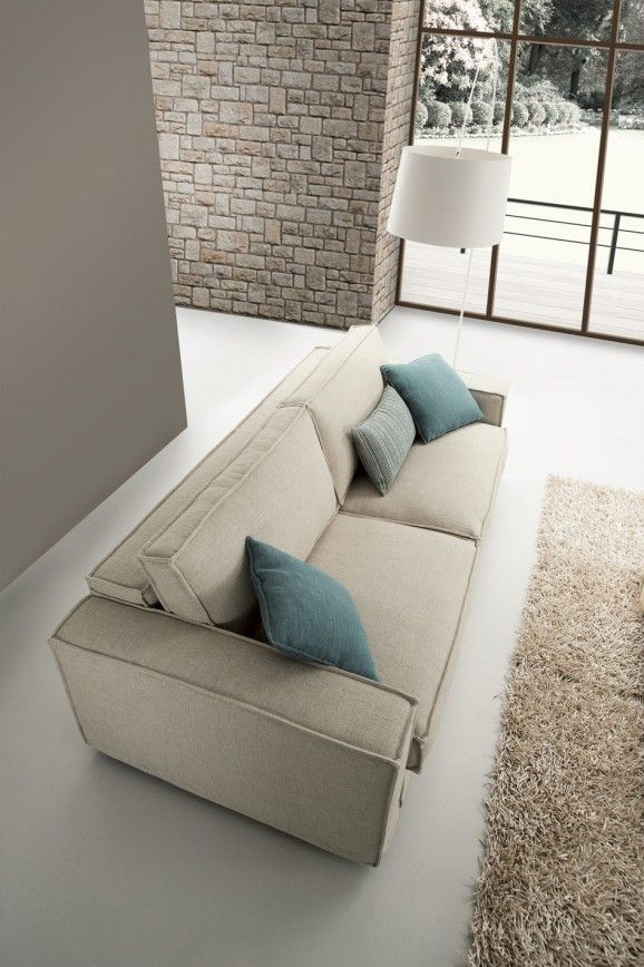 Sofa bed with contemporary square lines and decorated with corded