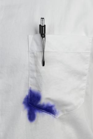 Close up of white shirt with blue ink stain on pocket - Lew Robertson / Getty Images
