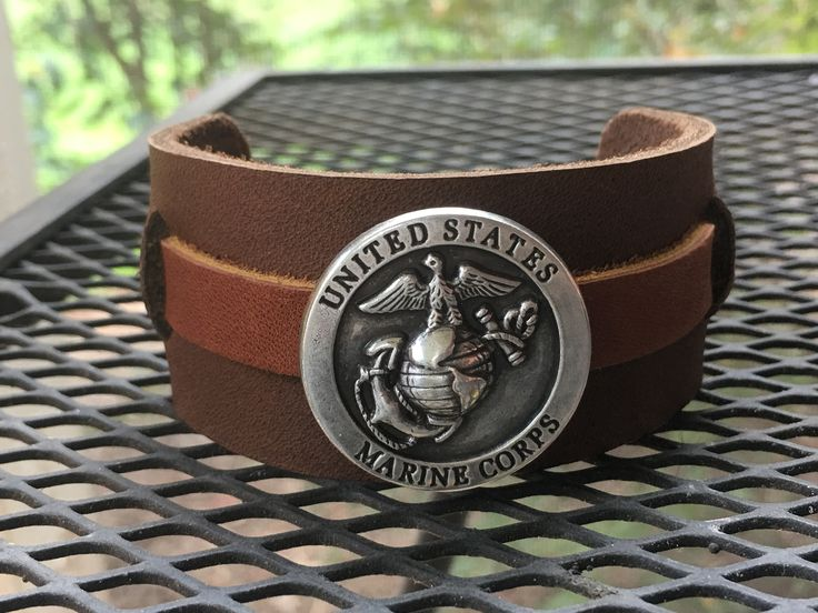 Leather USMC military cuff, one strap, metal USMC emblem, woven leather
