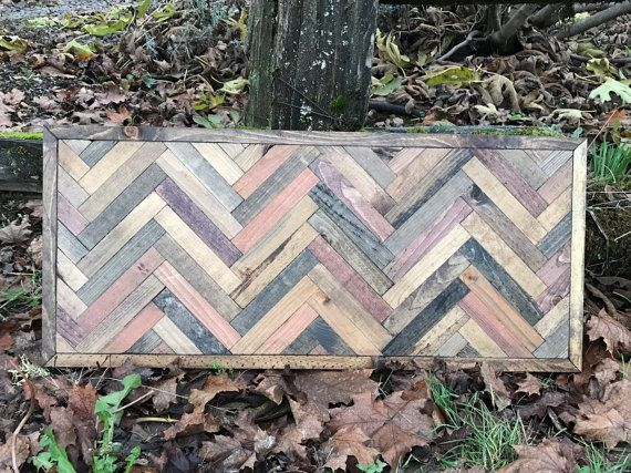 This herringbone wall hanging gives a wall a rustic modern twist. This piece is made with pine stained different colors to give it a rustic reclaimed wood look. The colors are quite exquisite together. No two pieces are the same, making this piece completely one of kind. I carefully choose the wood and thoughtfully choose which colors to stain them to give them the most enhancing look possible. This measures 30x13 and it comes with a preinstalled wire for hanging.  This piece also can be…