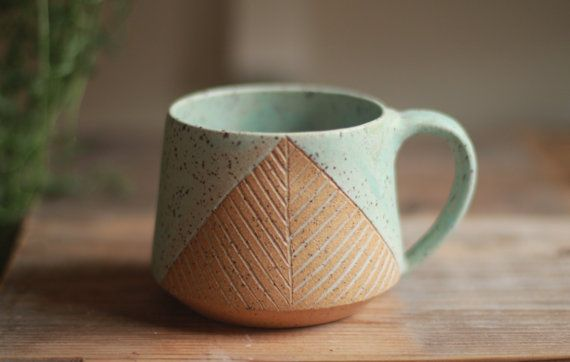 Handcrafted mug inspired in part by mid-century Scandinavian design as well as a modern rustic aesthetic. Glazed in antique turquoise over speckled clay with a hand etched herringbone design. This mug holds 14-16oz of your favorite beverage.  Each piece is thrown by hand at my home studio on the Central Coast of California. *microwave and dishwasher safe. *non-toxic lead free and food safe glaze.