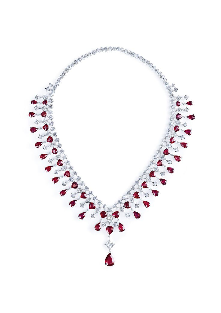 Necklace in 18K white gold set with 1 pearshaped ruby (approx. 4.41 cts), 45 pear-shaped rubies (approx. 48.90 cts), 1 princess-cut diamond (approx. 1.77 cts) and 158 brilliantcut diamonds (approx. 23.89 cts).