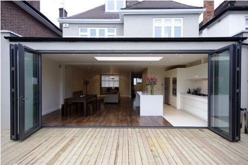 Constructing a new addition to this Sydney home to include bi-fold doors leading out onto a large deck platform - Building Works Australia, Building Construction, Dural, NSW, 2158 - TrueLocal