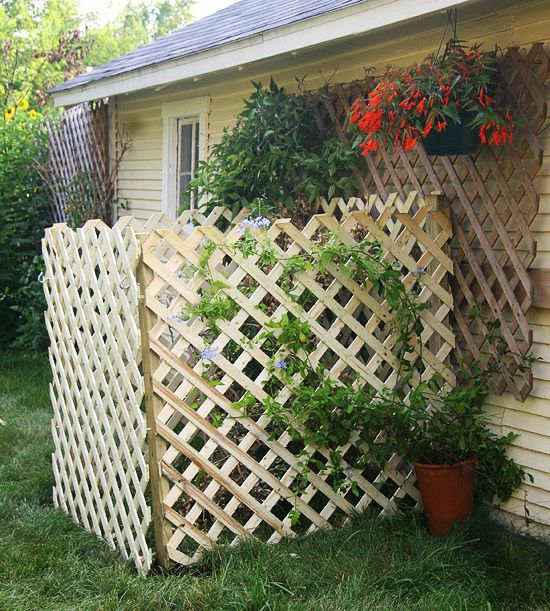 I like this idea for a compost bin!  Putting the little trellis as a gate around it with creeping plants is cute, and will eventually completely screen it from view.  I would be afraid to put it this close to a building, but otherwise, LOVE it!!