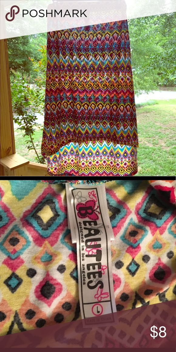 Girls sz L (10-12) high low tribal print skirt Beautees girls size large (fits 10-12) tribal print high low skirt. So cute and sweet-my daughter LOVED this skirt, but has now outgrown it! Beautees Bottoms Skirts