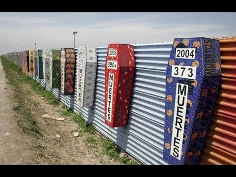 Makeshift coffins affixed to the Mexican side of the US-MX border fence, commemorating the yearly tally of Mexicans killed while trying to cross into the United States from Mexico.