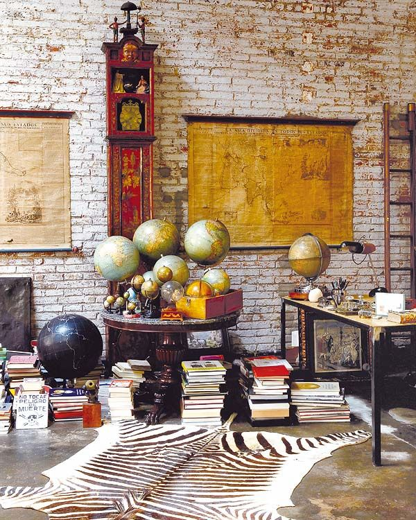 Loft living to my taste. Yes. Globes galore. Love and collect them too. ~ Di.
