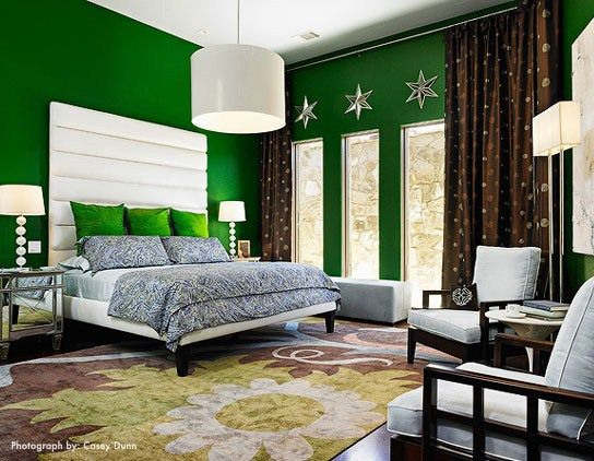 Bright emerald walls and bedding in mostly grey and brown bedroom