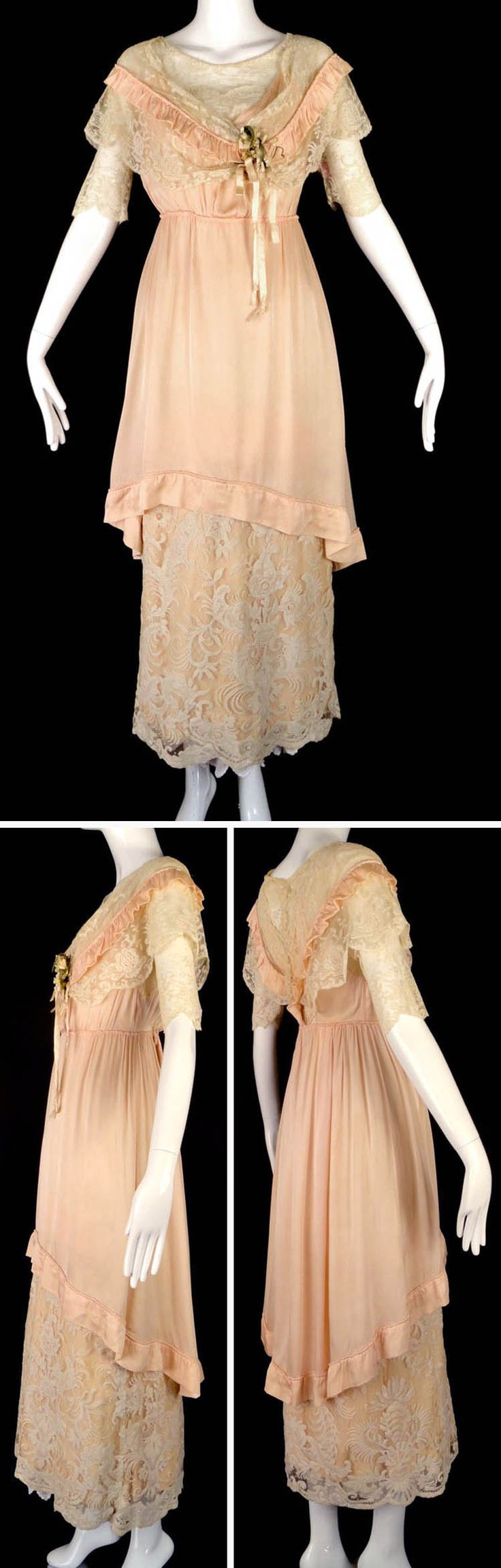 Dress ca.1912. Pink silk bodice with lace modesty & scoop neckline. Shawl collar of white lace & pink silk ruffle drapes around shoulders & meets on left with cluster of white orange blossoms & silk ribbons. Short, set-in lace sleeves, unlined. Bodice falls to natural waistline with slender, gathered skirt in muslin that has lower skirt in white lace with pink silk beneath. Shorter overskirt has self-piped border at bottom & asymmetrical hemline. Snap & hook closures in back. Vintage Martini
