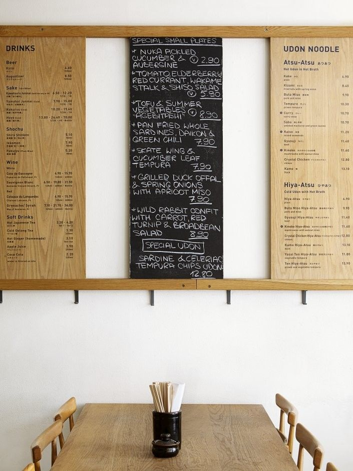 Koya Japanese Udon Noodle Bar in Soho, London contrast of printed wood panels with handwritten chalk/ slate panel