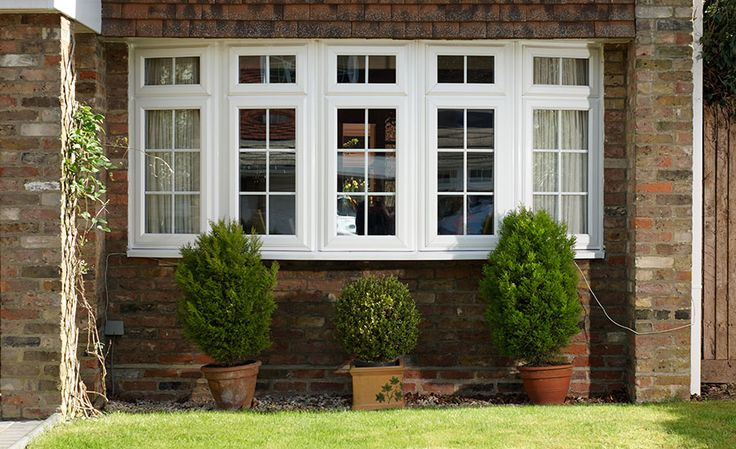 White uPVC bay window with Georgian inserts