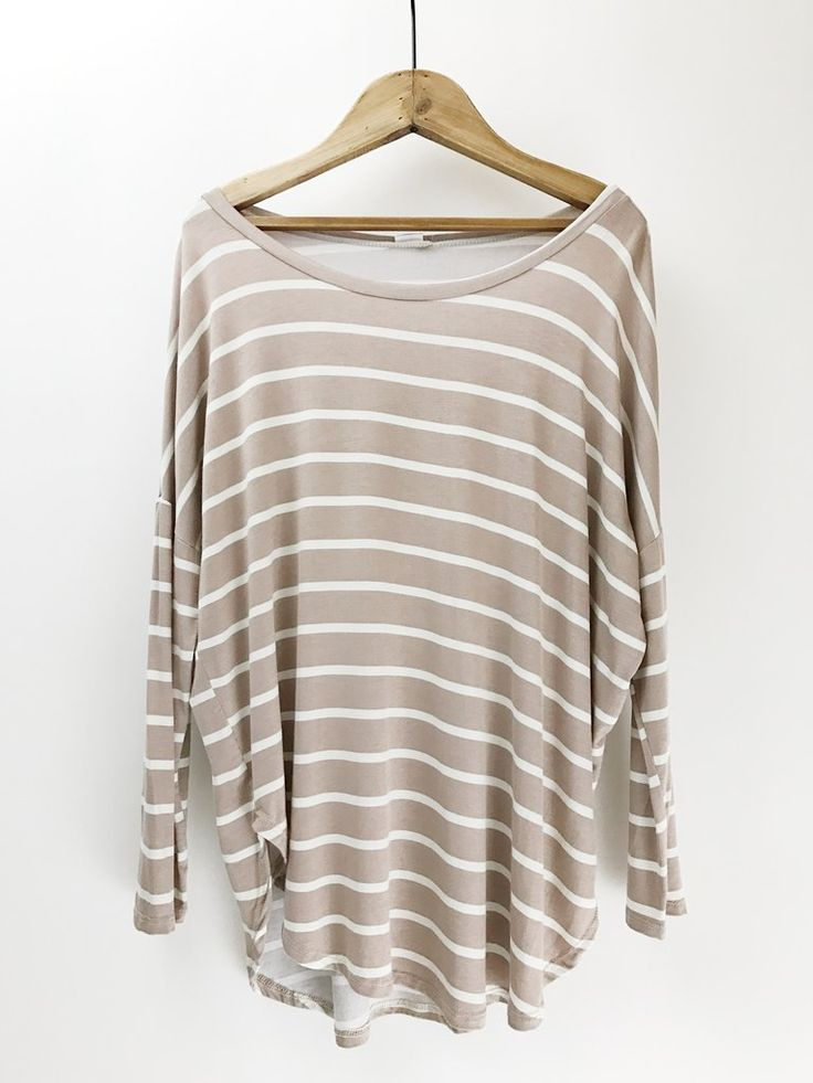 Striped Slouchy Top. Slouchy for the win!  This casual and cute Striped Slouchy Top features a dolman sleeve, wide neck, and round hem.  Perfect for achieving that effortless looked. Casual outfit. Boutique style. therollinj.com