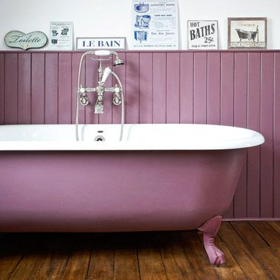 Plum paint, used on this tub's sides and on the surrounding wainscoting, gives it an updated look that's right at home with dark-stained wood floors. |  Photo: Heather Lewin/IPC Images | thisoldhouse.com