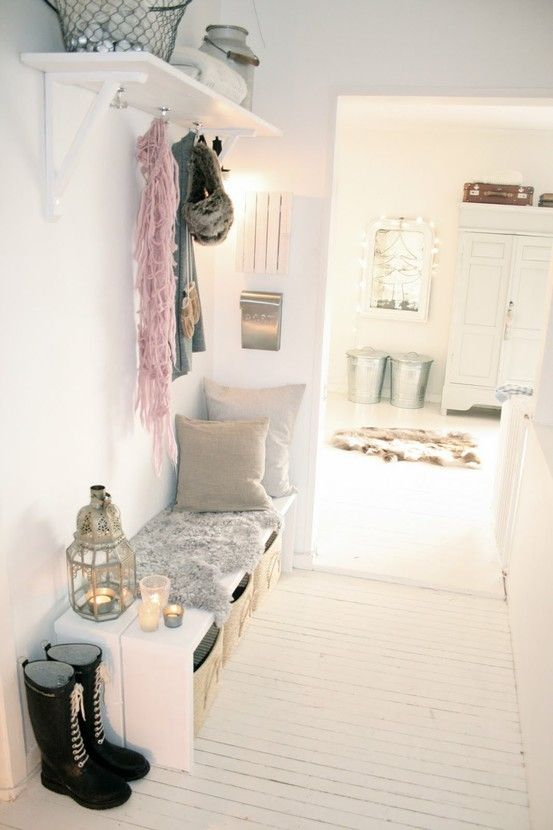 Make your own mud room with some benches, shelves, and storage to change an entryway, and of course add some tin accents for the decor // mud room