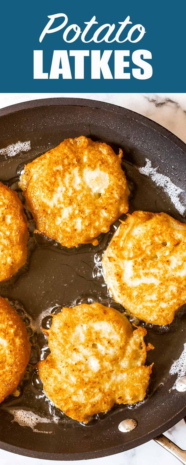 Potato Latkes! Our deli-style version is made in the food-processor. Crispy on the outside and creamy on the inside. Serve hot with plenty of sour cream and applesauce! #Latkes #Potato #Hanukkah #JewishFood