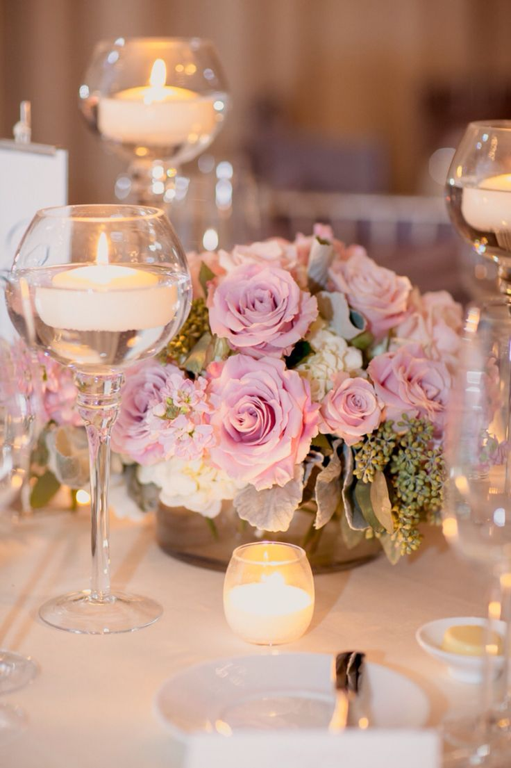 Caroline like this, except with pink tone roses