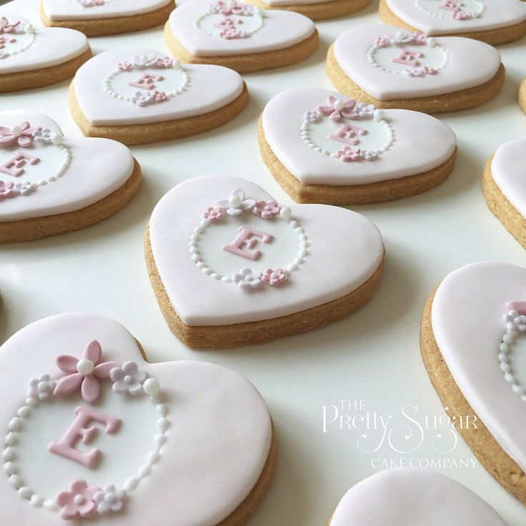 Hearts initial cookies in pink and white with sugar blossoms detail for a christening