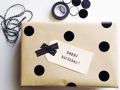 Nice idea to jazz up plain wrapping paper with stickers