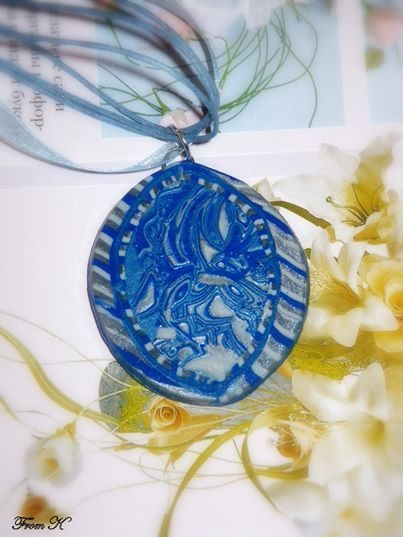 Blue Paisley Oval Pendant. This unique necklace made with polymer clay, using the Hidden Magic technique. Clay was conditioned, layered, imprinted with a paisley design and finally carved of the top layer to reveal the beautiful result. Have been sanded, buffed and sealed for a silky smooth finish. One of a kind necklace for people who aren`t afraid to stand out from the crowd. About 4x5cm big. Finished with 41cm long ribbon and cotton cord with a lobster claw clasp and extend chain. 20.00…