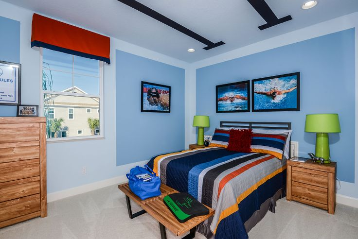 Swim themed bedroom. Joe wants swim, the lane line ceiling is interesting. Like all the colors.